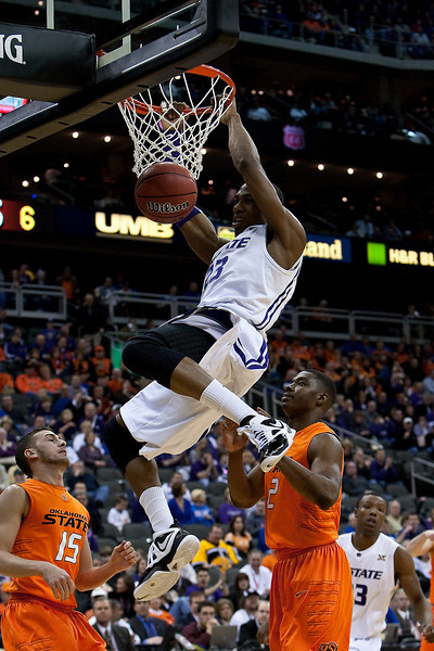 11 March 2010: Kansas State Wildcats forward Dominique Sutton (23) slam dunks during the quarterfinals of the Phillips 66 Big 12 Men's Basketball Championship.  The Kansas State Wildcats defeated the Oklahoma State Cowboys 83-64 at Sprint Center in Kansas City, Missouri.