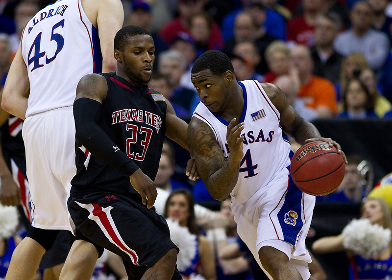 11 March 2010: Texas Tech Red Raiders guard Nick Okorie (23) defends Kansas Jayhawks guard Sherron Collins (4) during the quarterfinals of the Phillips 66 Big 12 Men's Basketball Championship.  The Kansas Jayhawks defeated the Texas Tech Red Raiders 80-68 at Sprint Center in Kansas City, Missouri.