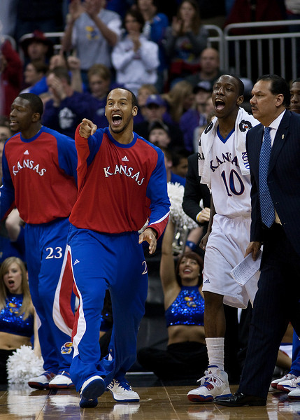 12 March 2010: The Kansas bench celebrates after a play during the semifinals of the Phillips 66 Big 12 Men's Basketball Championship.  The Kansas Jayhawks defeated the Texas A&M Aggies 79-66 at Sprint Center in Kansas City, Missouri.