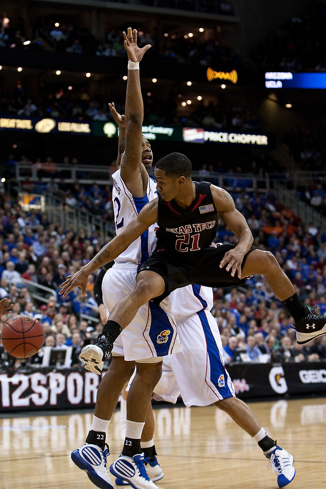 11 March 2010: Texas Tech Red Raiders guard John Roberson (21) passes the ball during the quarterfinals of the Phillips 66 Big 12 Men's Basketball Championship.  The Kansas Jayhawks defeated the Texas Tech Red Raiders 80-68 at Sprint Center in Kansas City, Missouri.