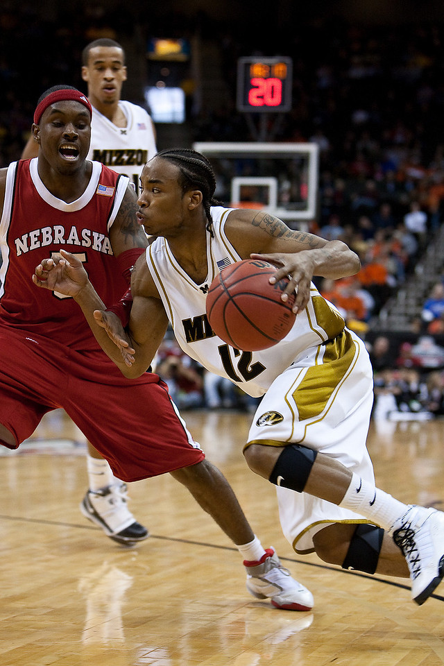 10 March 2010: Missouri Tigers guard Marcus Denmon (12) attempts to drive past Nebraska Cornhuskers guard Sek Henry (5) during the first round of the Phillips 66 Big 12 Men's Basketball Championship.  The Nebraska Cornhuskers defeated the Missouri Tigers 75-60 at Sprint Center in Kansas City, Missouri.
