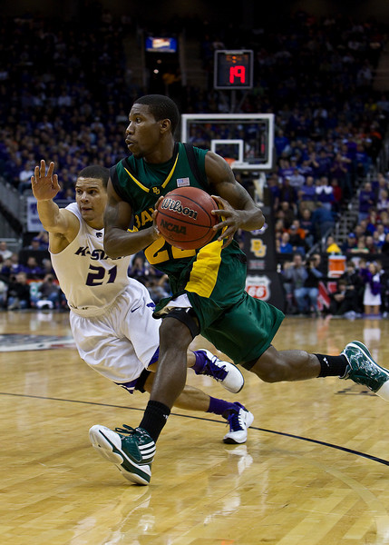 12 March 2010: Baylor Bears guard A.J. Walton (22) drives past Kansas State Wildcats guard Denis Clemente (21) during the semifinals of the Phillips 66 Big 12 Men's Basketball Championship.  The Kansas State Wildcats defeated the Baylor Bears 82-75 at Sprint Center in Kansas City, Missouri.