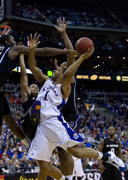 13 March 2010: Kansas Jayhawks guard Xavier Henry (1) goes up for a shot in traffic during the Phillips 66 Big 12 Men's Basketball Championship Final.  The Kansas Jayhawks defeated the Kansas State Wildcats 72-64 at Sprint Center in Kansas City, Missouri.