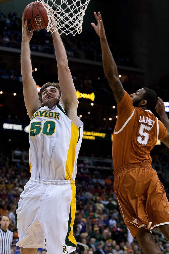 11 March 2010: Baylor Bears center Josh Lomers (50) goes up for a dunk during the quarterfinals of the Phillips 66 Big 12 Men's Basketball Championship.  The Baylor Bears led the Texas Longhorns 43-39 at the half at Sprint Center in Kansas City, Missouri.