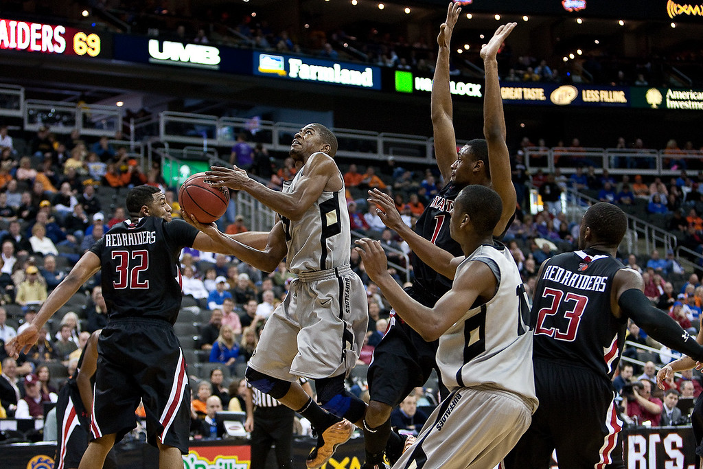 10 March 2010: Colorado Buffaloes guard Cory Higgins (11) attempts a shot in the lane during the first round of the Phillips 66 Big 12 Men's Basketball Championship.  The Texas Tech Red Raiders defeated the Colorado Buffaloes 82-67 at Sprint Center in Kansas City, Missouri.