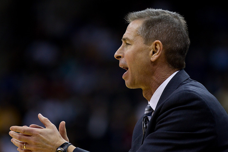 10 March 2010: Colorado Buffaloes head coach Jeff Bzdelik encourages his team during the first round of the Phillips 66 Big 12 Men's Basketball Championship.  The Texas Tech Red Raiders defeated the Colorado Buffaloes 82-67 at Sprint Center in Kansas City, Missouri.