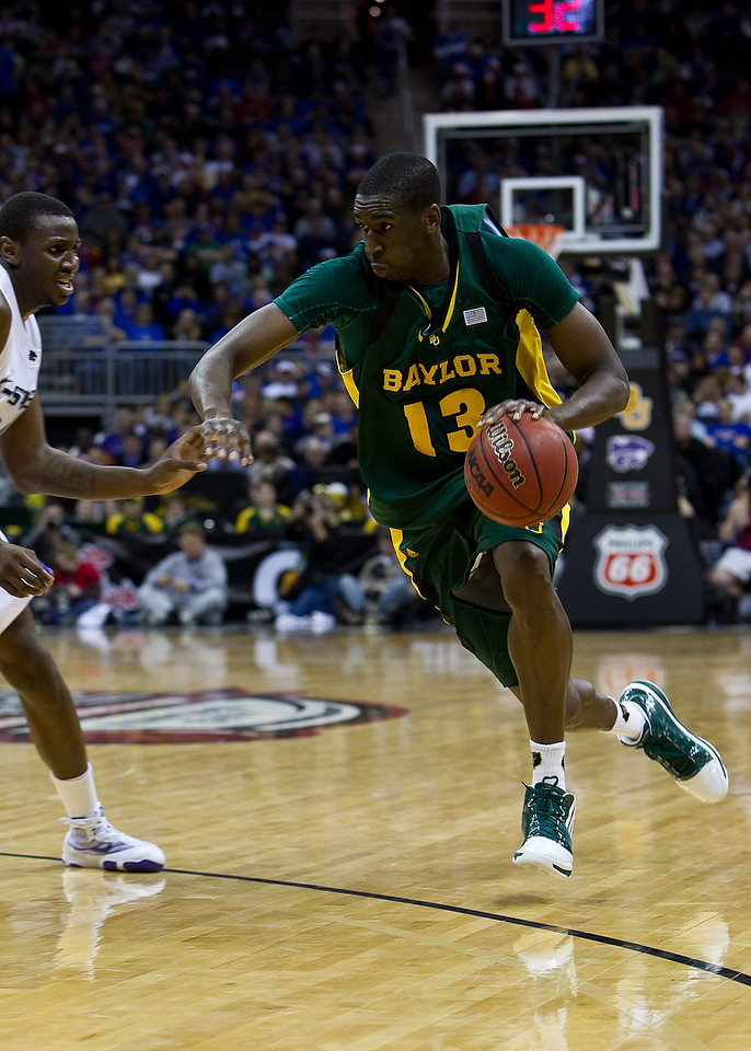 12 March 2010: Baylor Bears forward Ekpe Udoh (13) drives with the ball during the semifinals of the Phillips 66 Big 12 Men's Basketball Championship.  The Kansas State Wildcats defeated the Baylor Bears 82-75 at Sprint Center in Kansas City, Missouri.