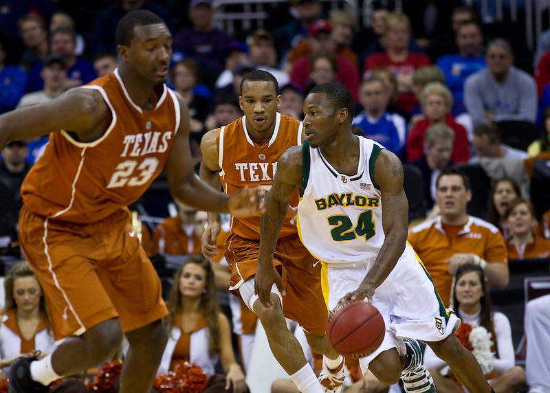 11 March 2010: Baylor Bears guard LaceDarius Dunn (24) brings the ball up court during the quarterfinals of the Phillips 66 Big 12 Men's Basketball Championship.  The Baylor Bears defeated the Texas Longhorns 86-67 at Sprint Center in Kansas City, Missouri.