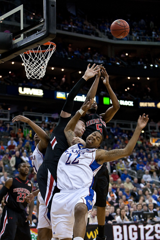 11 March 2010: Texas Tech Red Raiders forward Darko Cohadarevic (31) and Kansas Jayhawks forward Marcus Morris (22) get tangled up under the basket during the quarterfinals of the Phillips 66 Big 12 Men's Basketball Championship.  The Kansas Jayhawks defeated the Texas Tech Red Raiders 80-68 at Sprint Center in Kansas City, Missouri.
