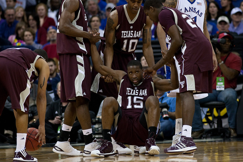 12 March 2010: Texas A&M teammates help guard Donald Sloan (15) to his feet during the semifinals of the Phillips 66 Big 12 Men's Basketball Championship.  The Kansas Jayhawks defeated the Texas A&M Aggies 79-66 at Sprint Center in Kansas City, Missouri.