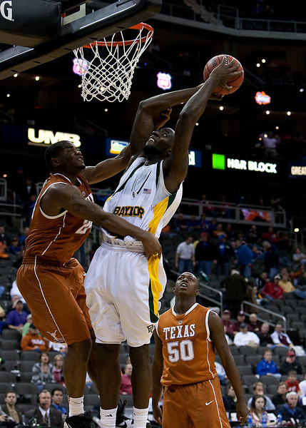 11 March 2010: Baylor Bears forward Quincy Acy (4) goes up for a shot in front of Texas Longhorns guard Justin Mason (24) during the quarterfinals of the Phillips 66 Big 12 Men's Basketball Championship.  The Baylor Bears defeated the Texas Longhorns 86-67 at Sprint Center in Kansas City, Missouri.