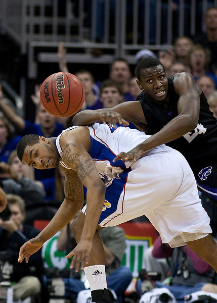 13 March 2010: Kansas State Wildcats forward Curtis Kelly (24) and Kansas Jayhawks forward Marcus Morris (22) battle for a loose ball during the Phillips 66 Big 12 Men's Basketball Championship Final.  The Kansas Jayhawks defeated the Kansas State Wildcats 72-64 at Sprint Center in Kansas City, Missouri.