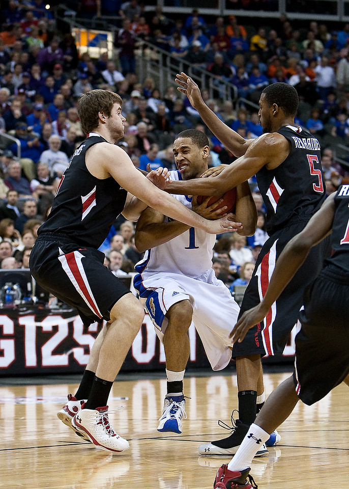 11 March 2010: Kansas Jayhawks guard Xavier Henry (1) tries to maintain possession during the quarterfinals of the Phillips 66 Big 12 Men's Basketball Championship.  The Kansas Jayhawks defeated the Texas Tech Red Raiders 80-68 at Sprint Center in Kansas City, Missouri.