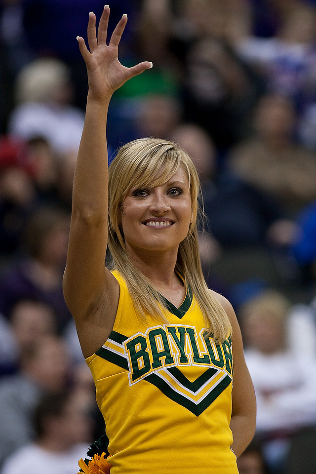 12 March 2010: A Baylor yell leader holds up the bear claw during the semifinals of the Phillips 66 Big 12 Men's Basketball Championship.  The Kansas State Wildcats defeated the Baylor Bears 82-75 at Sprint Center in Kansas City, Missouri.