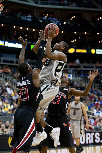 10 March 2010: Colorado Buffaloes guard Alec Burks (10) goes up for a shot during the first round of the Phillips 66 Big 12 Men's Basketball Championship.  The Texas Tech Red Raiders defeated the Colorado Buffaloes 82-67 at Sprint Center in Kansas City, Missouri.