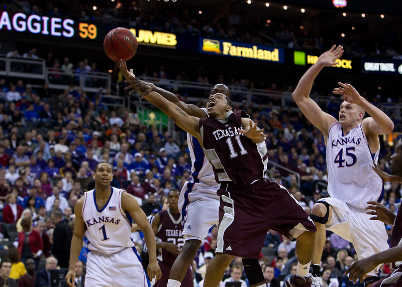 12 March 2010: Texas A&M Aggies guard B.J. Holmes (11)  gets fouled during the semifinals of the Phillips 66 Big 12 Men's Basketball Championship.  The Kansas Jayhawks defeated the Texas A&M Aggies 79-66 at Sprint Center in Kansas City, Missouri.