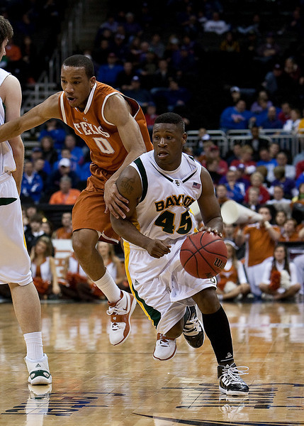 11 March 2010: Baylor Bears guard Tweety Carter (45) gets past Texas Longhorns guard Avery Bradley (0) during the quarterfinals of the Phillips 66 Big 12 Men's Basketball Championship.  The Baylor Bears defeated the Texas Longhorns 86-67 at Sprint Center in Kansas City, Missouri.