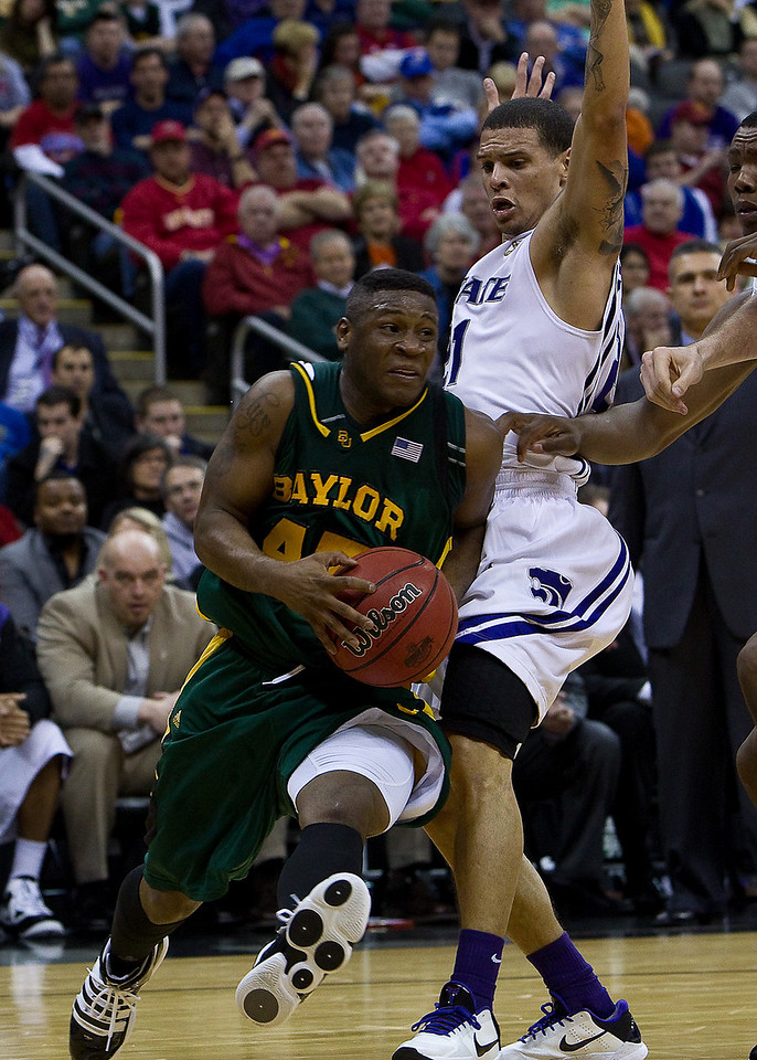 12 March 2010: Baylor Bears guard Tweety Carter (45) drives past Kansas State Wildcats guard Denis Clemente (21) during the semifinals of the Phillips 66 Big 12 Men's Basketball Championship.  The Kansas State Wildcats defeated the Baylor Bears 82-75 at Sprint Center in Kansas City, Missouri.
