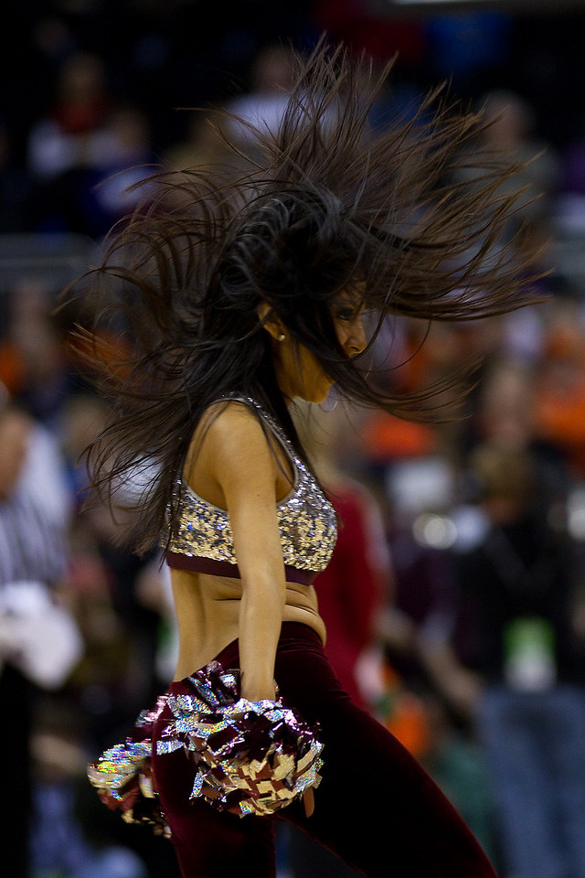 11 March 2010: A Texas A&M cheerleader entertains the crowd during the quarterfinals of the Phillips 66 Big 12 Men's Basketball Championship.  The Texas A&M Aggies defeated the Nebraska Cornhuskers 70-64 at Sprint Center in Kansas City, Missouri.