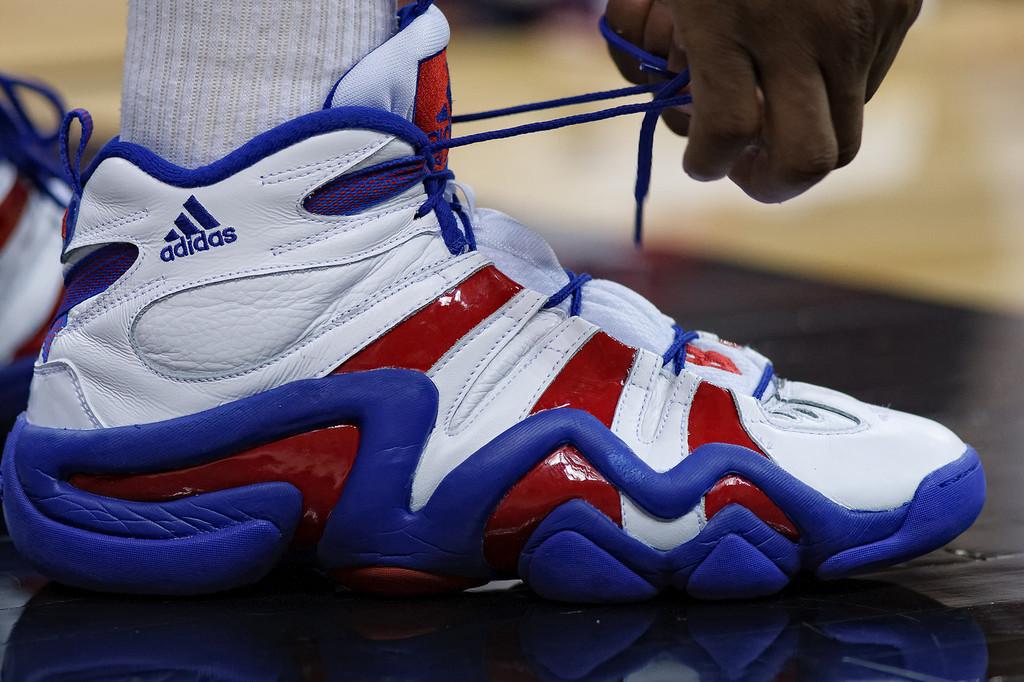 March 11, 2011: Kansas Jayhawks forward Marcus Morris (22) ties his shoe during the semifinals of the Phillips 66 Big 12 Men's Basketball Championship.  The Kansas Jayhawks defeated the Colorado Buffaloes 83-90 at Sprint Center in Kansas City, Missouri.