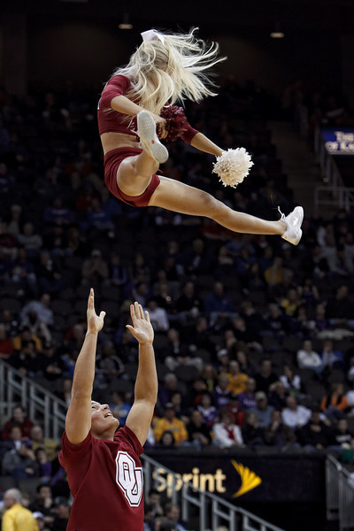 March 9, 2011: Oklahoma cheerleaders entertain the crowd during the first round of the Phillips 66 Big 12 Men's Basketball Championship.  The Oklahoma Sooners defeated the Baylor Bears 84-67 at Sprint Center in Kansas City, Missouri.