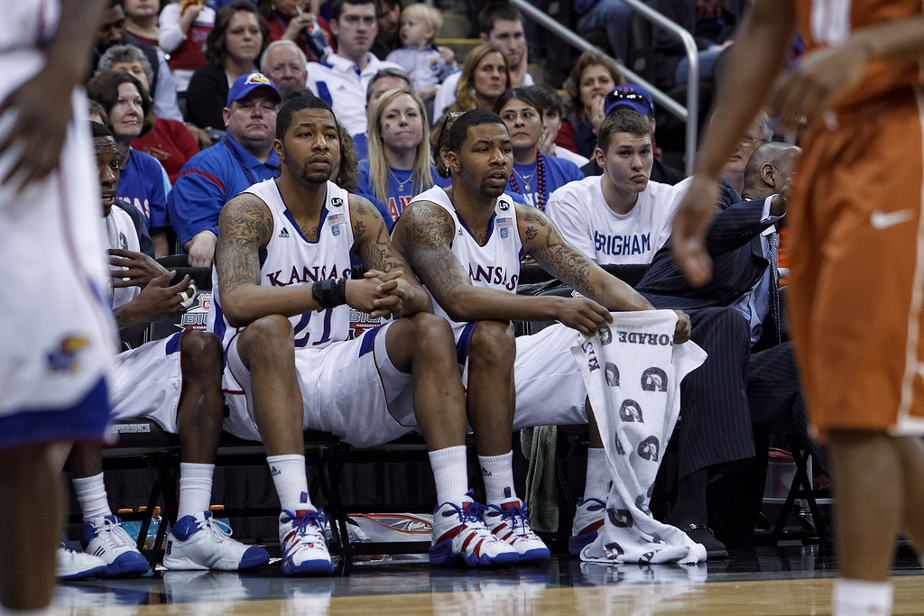 March 12, 2011: Kansas Jayhawks forwards Markieff Morris (21) and Marcus Morris (22) watch from the bench during the Phillips 66 Big 12 Men's Basketball Championship final.  The Kansas Jayhawks defeated the Texas Longhorns 73-85 at Sprint Center in Kansas City, Missouri.