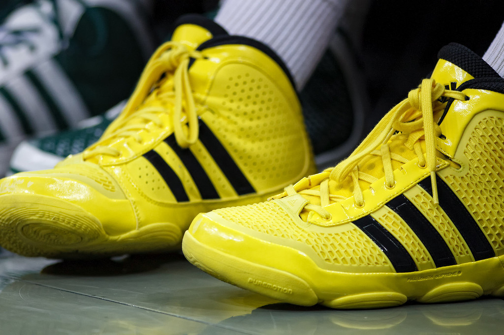 March 9, 2011: An unidentified Baylor players wears bright yellow shoes during the first round of the Phillips 66 Big 12 Men's Basketball Championship.  The Oklahoma Sooners defeated the Baylor Bears 84-67 at Sprint Center in Kansas City, Missouri.