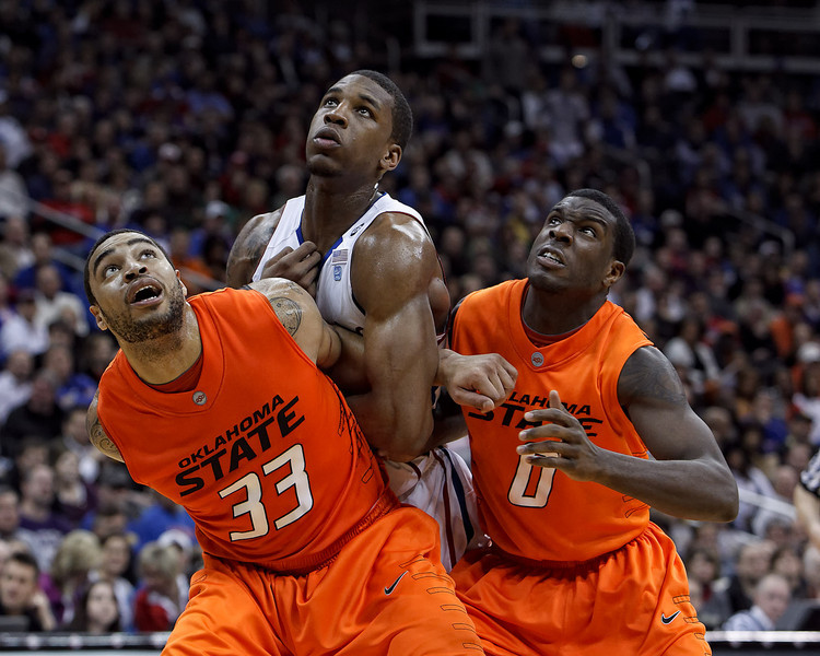 March 10, 2011: Oklahoma State Cowboys forward Marshall Moses (33) blocks out during a free throw attempt during the quarterfinals of the Phillips 66 Big 12 Men's Basketball Championship.  The Kansas Jayhawks defeated the Oklahoma State Cowboys 62-63 at Sprint Center in Kansas City, Missouri.
