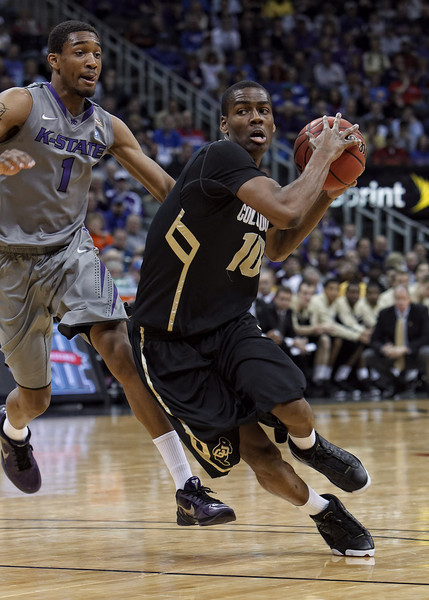 March 10, 2011: Colorado Buffaloes guard Alec Burks (10) drives past Kansas State Wildcats guard Shane Southwell (1) during the quarterfinals of the Phillips 66 Big 12 Men's Basketball Championship.  The Kansas State Wildcats led the Colorado Buffaloes 37-39 at the half at Sprint Center in Kansas City, Missouri.