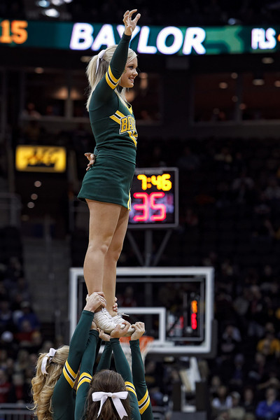 March 9, 2011: Baylor cheerleaders entertain the crowd during the first round of the Phillips 66 Big 12 Men's Basketball Championship.  The Oklahoma Sooners defeated the Baylor Bears 84-67 at Sprint Center in Kansas City, Missouri.