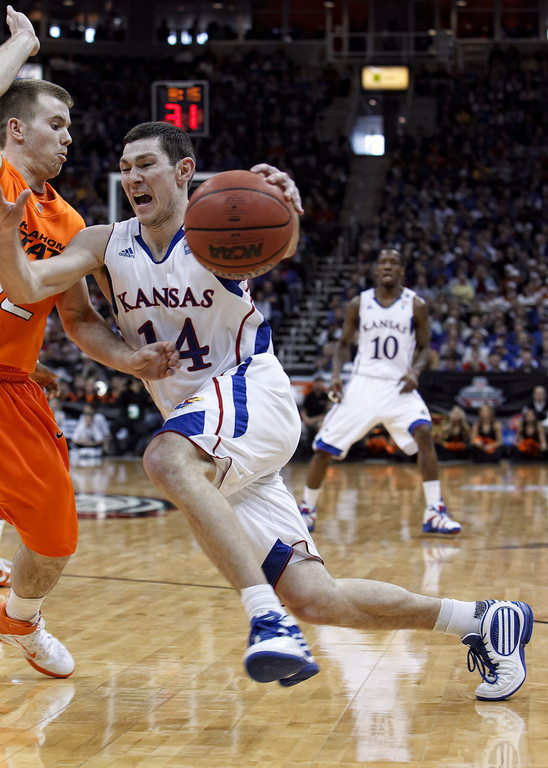 March 10, 2011: Kansas Jayhawks guard Tyrel Reed (14) drives with the ball during the quarterfinals of the Phillips 66 Big 12 Men's Basketball Championship.  The Kansas Jayhawks defeated the Oklahoma State Cowboys 62-63 at Sprint Center in Kansas City, Missouri.