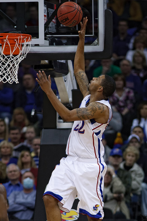 March 10, 2011: Kansas Jayhawks forward Marcus Morris (22) taps one in during the quarterfinals of the Phillips 66 Big 12 Men's Basketball Championship.  The Oklahoma State Cowboys led the Kansas Jayhawks 41-35 at the half at Sprint Center in Kansas City, Missouri.