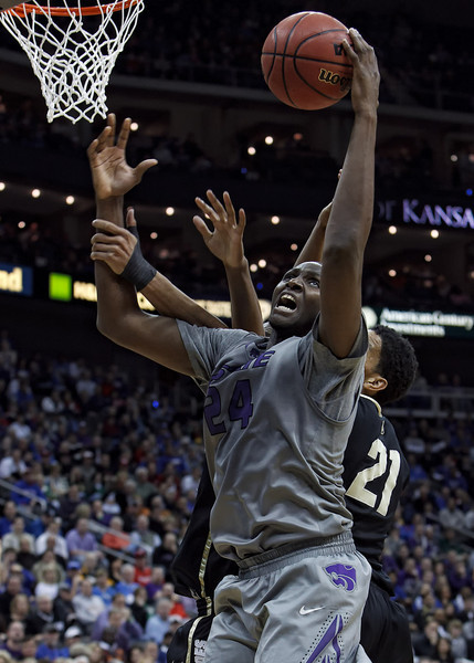 March 10, 2011: Kansas State Wildcats forward Curtis Kelly (24) goes to the rim during the quarterfinals of the Phillips 66 Big 12 Men's Basketball Championship.  The Colorado Buffaloes defeated the Kansas State Wildcats 87-75 at Sprint Center in Kansas City, Missouri.