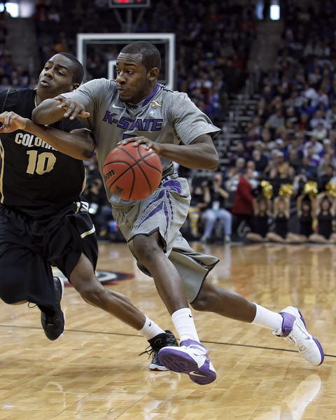 March 10, 2011: Kansas State Wildcats guard Devon Peterson (2) drives past Colorado Buffaloes guard Alec Burks (10) during the quarterfinals of the Phillips 66 Big 12 Men's Basketball Championship.  The Colorado Buffaloes defeated the Kansas State Wildcats 87-75 at Sprint Center in Kansas City, Missouri.