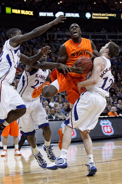 March 10, 2011: Oklahoma State Cowboys forward J.P. Olukemi (0) goes up in traffic during the quarterfinals of the Phillips 66 Big 12 Men's Basketball Championship.  The Oklahoma State Cowboys led the Kansas Jayhawks 41-35 at the half at Sprint Center in Kansas City, Missouri.