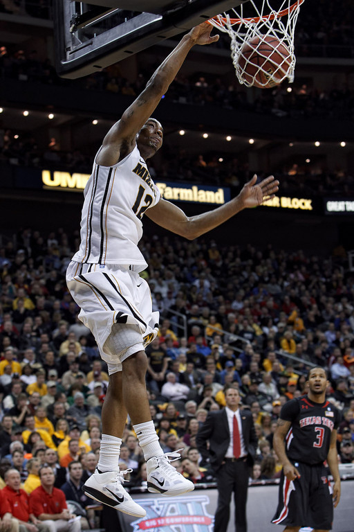 March 9, 2011: Missouri Tigers guard Marcus Denmon (12) slam dunks during the first round of the Phillips 66 Big 12 Men's Basketball Championship.  The Missouri Tigers led the Texas Tech Red Raiders 44-48 at the half at Sprint Center in Kansas City, Missouri.