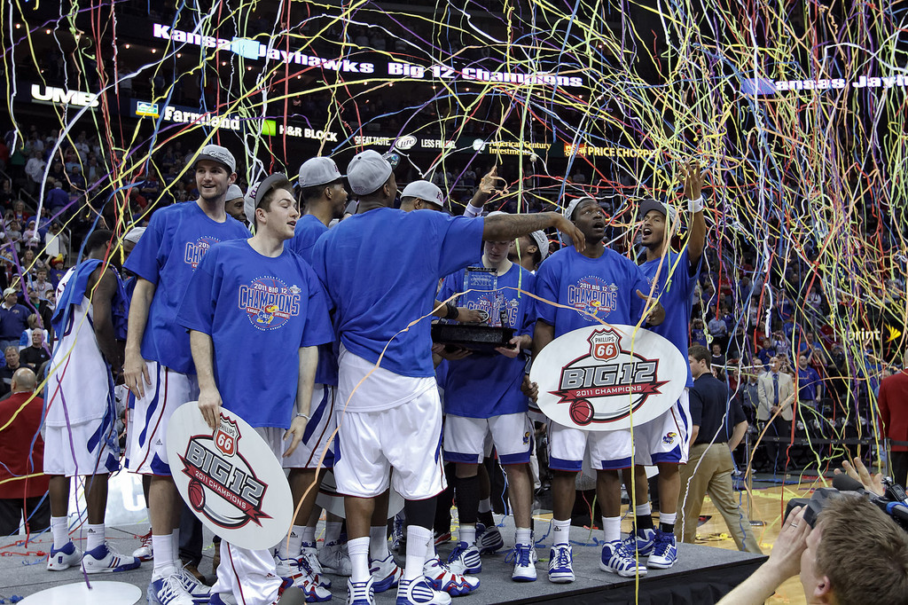 March 12, 2011: Confetti falls as the team celebrates after the Phillips 66 Big 12 Men's Basketball Championship final.  The Kansas Jayhawks defeated the Texas Longhorns 73-85 at Sprint Center in Kansas City, Missouri.