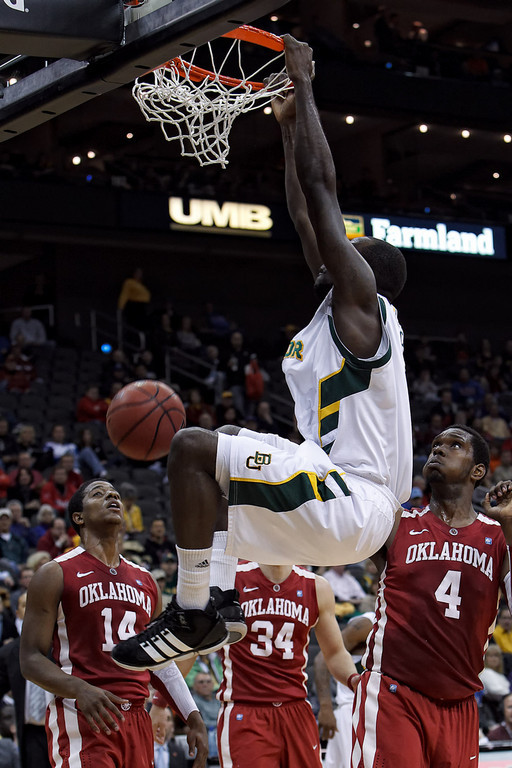 March 9, 2011: Baylor Bears forward Quincy Acy (4) slam dunks during the first round of the Phillips 66 Big 12 Men's Basketball Championship.  The Oklahoma Sooners defeated the Baylor Bears 84-67 at Sprint Center in Kansas City, Missouri.