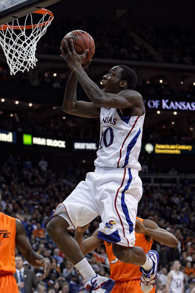 March 10, 2011: Kansas Jayhawks guard Tyshawn Taylor (10) goes up for a shot during the quarterfinals of the Phillips 66 Big 12 Men's Basketball Championship.  The Kansas Jayhawks defeated the Oklahoma State Cowboys 62-63 at Sprint Center in Kansas City, Missouri.