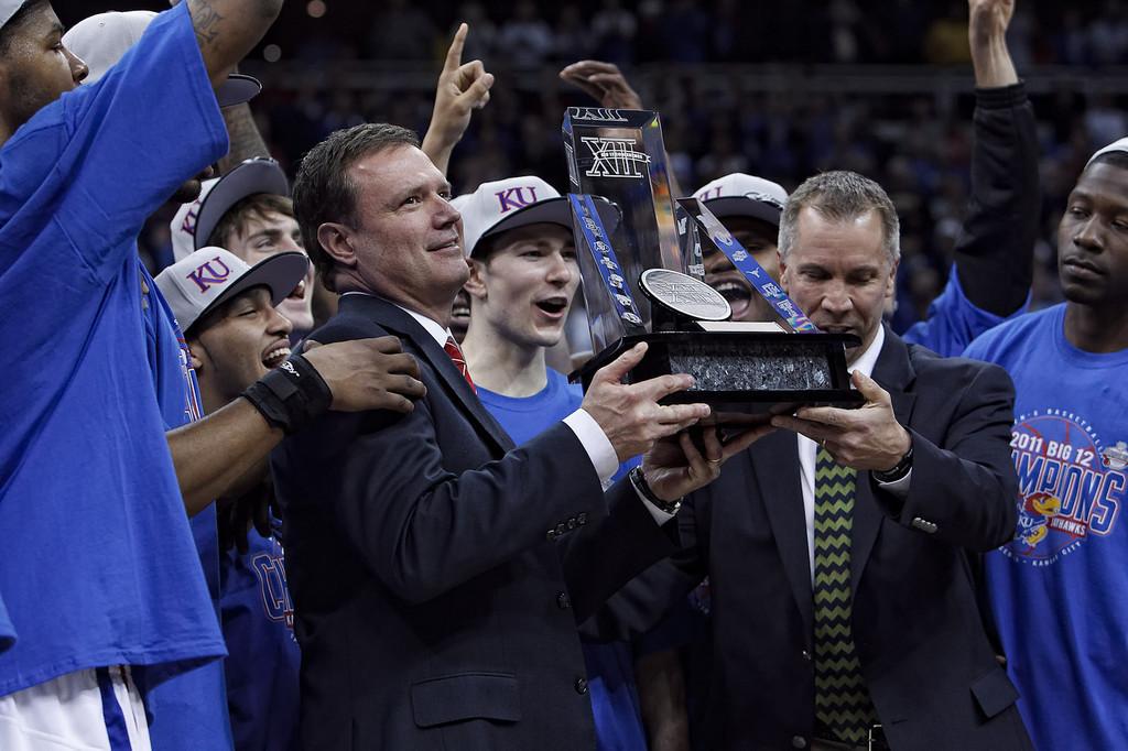 March 12, 2011: Kansas Jayhawks head coach Bill Self holds up the Big 12 trophy after the Phillips 66 Big 12 Men's Basketball Championship final.  The Kansas Jayhawks defeated the Texas Longhorns 73-85 at Sprint Center in Kansas City, Missouri.