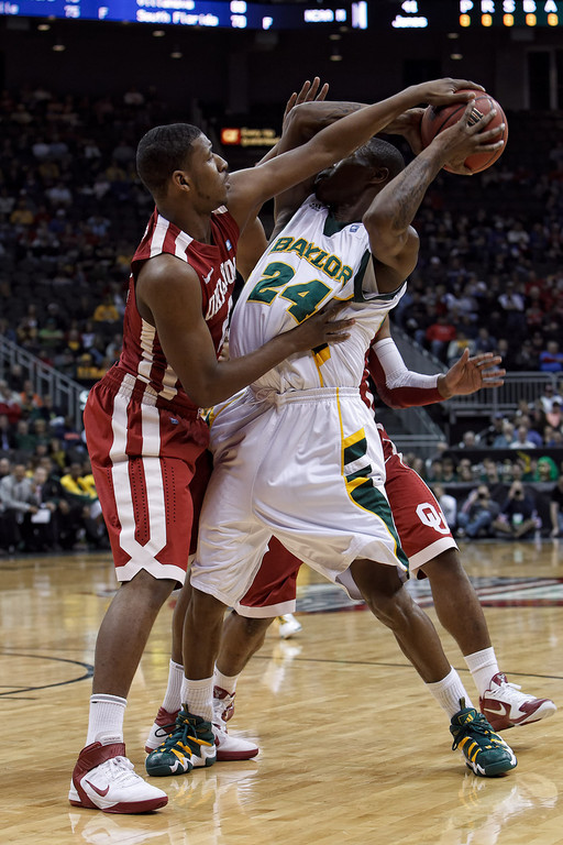 March 9, 2011: Baylor Bears guard LaceDarius Dunn (24) gets double teamed during the first round of the Phillips 66 Big 12 Men's Basketball Championship.  The Oklahoma Sooners defeated the Baylor Bears 84-67 at Sprint Center in Kansas City, Missouri.
