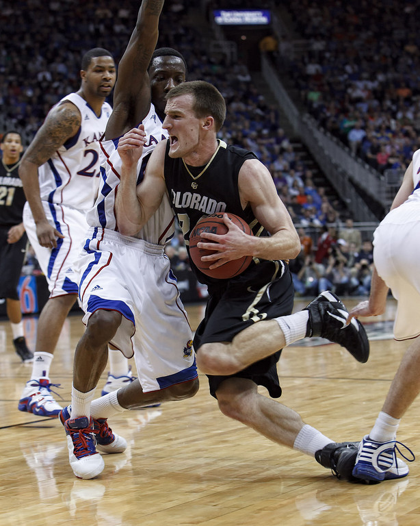 March 11, 2011: Colorado Buffaloes guard Levi Knutson (24) loses his footing during the semifinals of the Phillips 66 Big 12 Men's Basketball Championship.  The Kansas Jayhawks defeated the Colorado Buffaloes 83-90 at Sprint Center in Kansas City, Missouri.