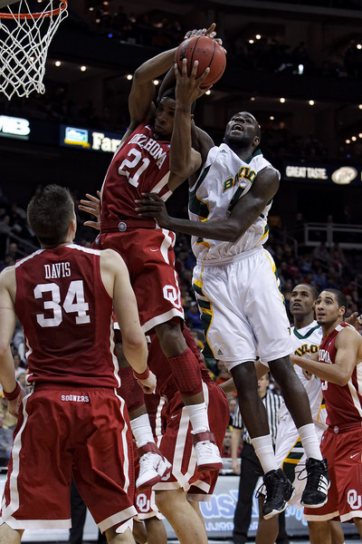 March 9, 2011: Oklahoma Sooners guard/forward Cameron Clark (21) and Baylor Bears forward Quincy Acy (4) battle for a rebound during the first round of the Phillips 66 Big 12 Men's Basketball Championship.  The Oklahoma Sooners defeated the Baylor Bears 84-67 at Sprint Center in Kansas City, Missouri.