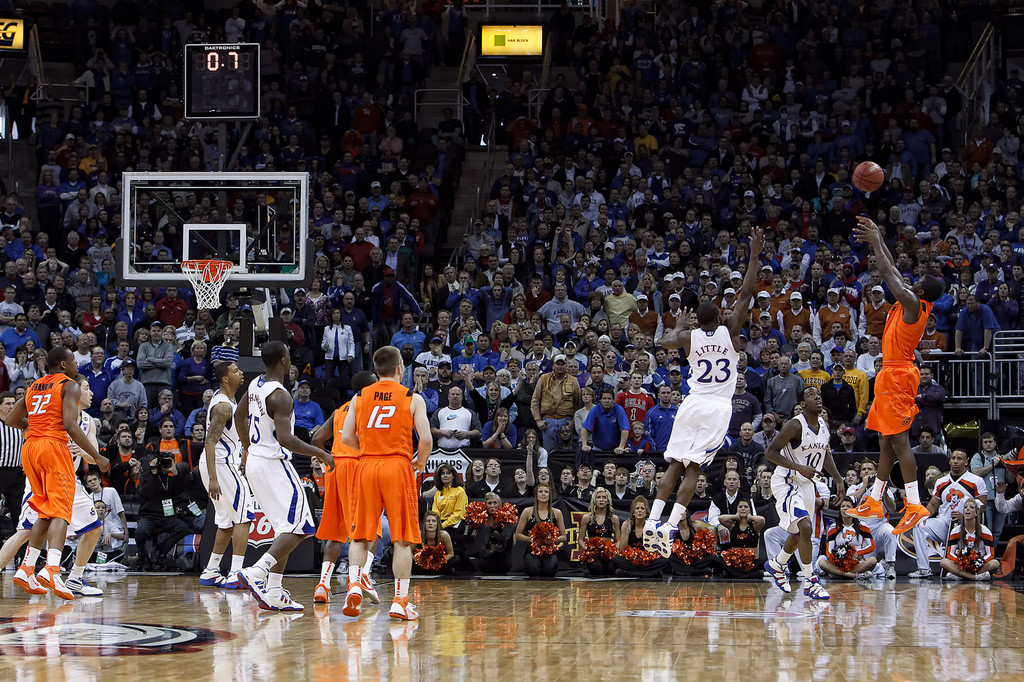 March 10, 2011: Oklahoma State Cowboys forward J.P. Olukemi (0) attempts a shot with .7 seconds remaining and down by one during the quarterfinals of the Phillips 66 Big 12 Men's Basketball Championship.  The Kansas Jayhawks defeated the Oklahoma State Cowboys 62-63 at Sprint Center in Kansas City, Missouri.