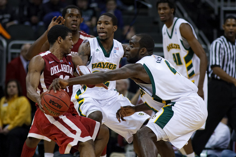 March 9, 2011: Baylor Bears forward Quincy Acy (4) goes for a steal during the first round of the Phillips 66 Big 12 Men's Basketball Championship.  The Oklahoma Sooners defeated the Baylor Bears 84-67 at Sprint Center in Kansas City, Missouri.