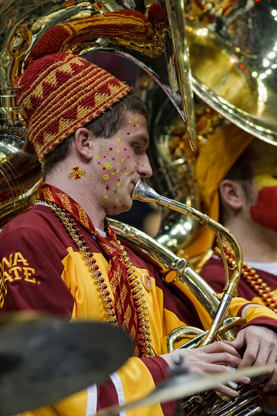 March 9, 2011: A member of the Iowa State band plays during a timeout at the first round of the Phillips 66 Big 12 Men's Basketball Championship.  The Iowa State Cyclones led the Colorado Buffaloes 26-28 at the half at Sprint Center in Kansas City, Missouri.