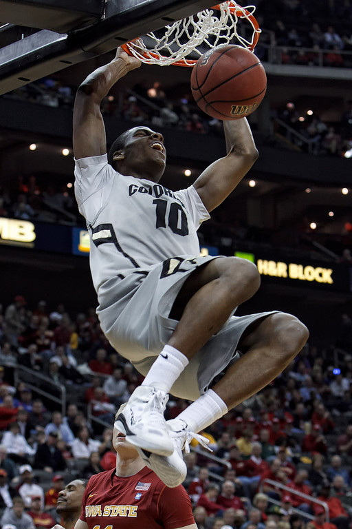 March 9, 2011: Colorado Buffaloes guard Alec Burks (10) hangs on the rim after a slam dunk during the first round of the Phillips 66 Big 12 Men's Basketball Championship.  The Iowa State Cyclones led the Colorado Buffaloes 26-28 at the half at Sprint Center in Kansas City, Missouri.
