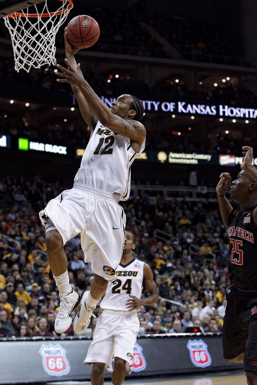 March 9, 2011: Missouri Tigers guard Marcus Denmon (12) lays one in during the first round of the Phillips 66 Big 12 Men's Basketball Championship.  The Missouri Tigers led the Texas Tech Red Raiders 44-48 at the half at Sprint Center in Kansas City, Missouri.