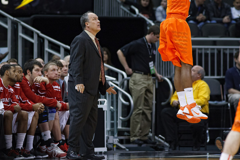 March 9, 2011: Nebraska Cornhuskers head coach Doc Sadler watches a three point attempt during the first round of the Phillips 66 Big 12 Men's Basketball Championship.  The Oklahoma State Cowboys led the Nebraska Cornhuskers 21-30 at the half at Sprint Center in Kansas City, Missouri.