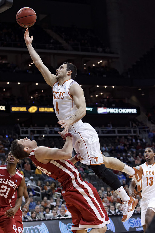 March 10, 2011: Texas Longhorns guard Dogus Balbay (4) goes up for a shot while Oklahoma Sooners guard Cade Davis (34) tries to draw a charge during the quarterfinals of the Phillips 66 Big 12 Men's Basketball Championship.  The Texas Longhorns led the Oklahoma Sooners 20-43 at the half at Sprint Center in Kansas City, Missouri.